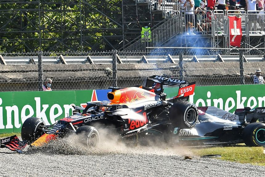 The pair collided at the first chicane and Max Verstappen's car wedged on top of Lewis Hamilton's in the gravel.