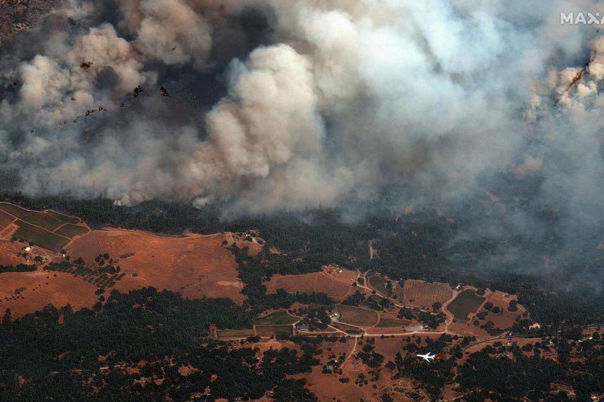 Smoke billowing from Caldor Fire, east of Sacramento, California, on Aug 25, 2021.
