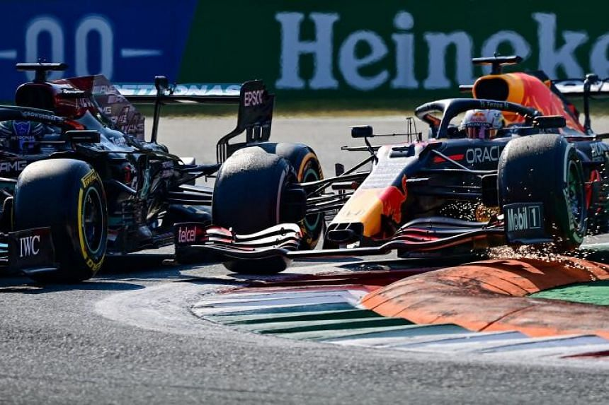 Red Bull's Dutch driver Max Verstappen (right) and Mercedes' British driver Lewis Hamilton collide at the Autodromo Nazionale circuit in Monza, on Sept 12, 2021.