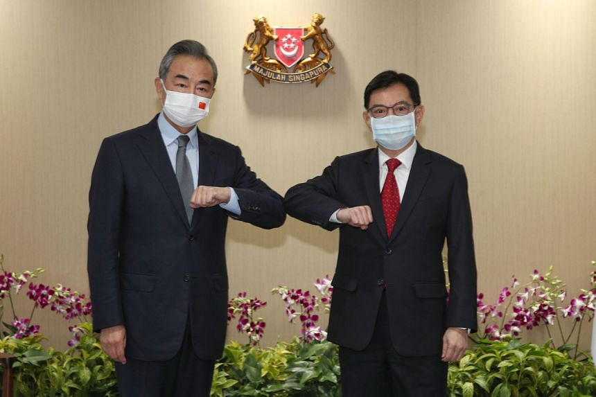 Chinese Foreign Minister Wang Yi (left) meeting Singapore DPM Heng Swee Keat at the Treasury on Sept 13, 2021.