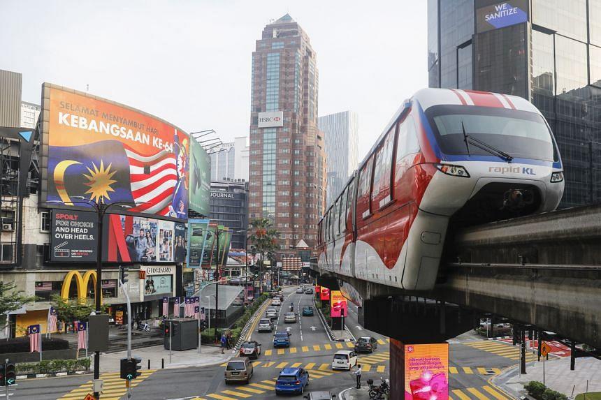 A Malaysian flag displayed on a big LCD screen at Kuala Lumpur, on Sept 7, 2021.