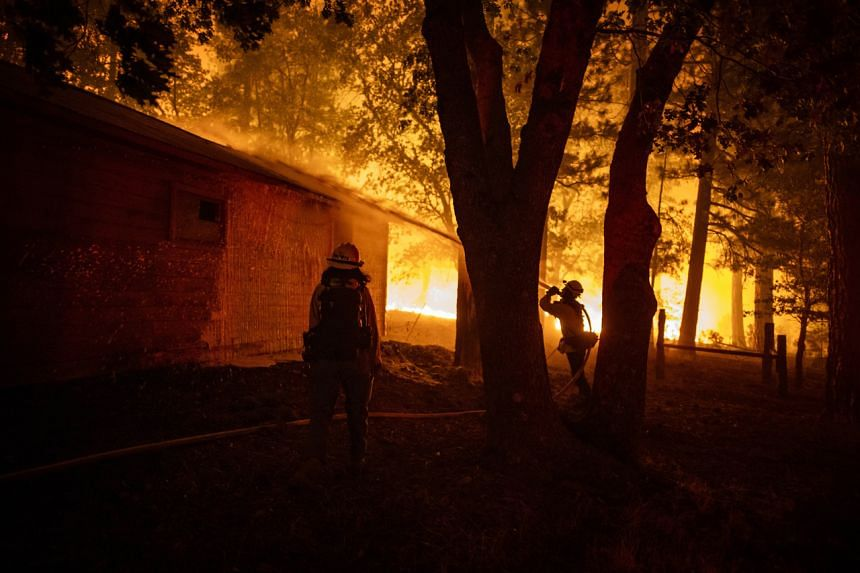 A fire crew battling the Dixie Fire near Taylorsville, California, on Aug 9, 2021.
