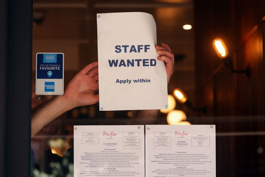 A staff wanted sign in the window of a restaurant in the Soho district of London on Sept. 7, 2021.