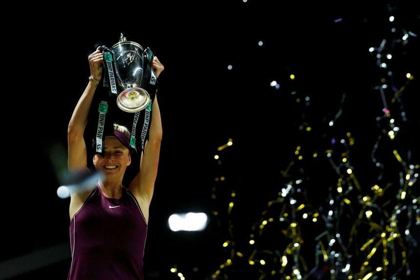 Ukraine's Elina Svitolina celebrates with the trophy after winning the 2018 final at the Singapore Indoor Stadium.