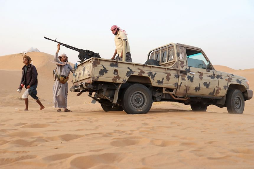 Armed men loyal to the government forces guard a site near the Safer oil fields in Marib, Yemen on Sept 12.