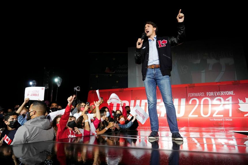 Canada's Prime Minister Justin Trudeau speaks at a drive-in rally in Oakville, Ontario, on Sept 12, 2021.