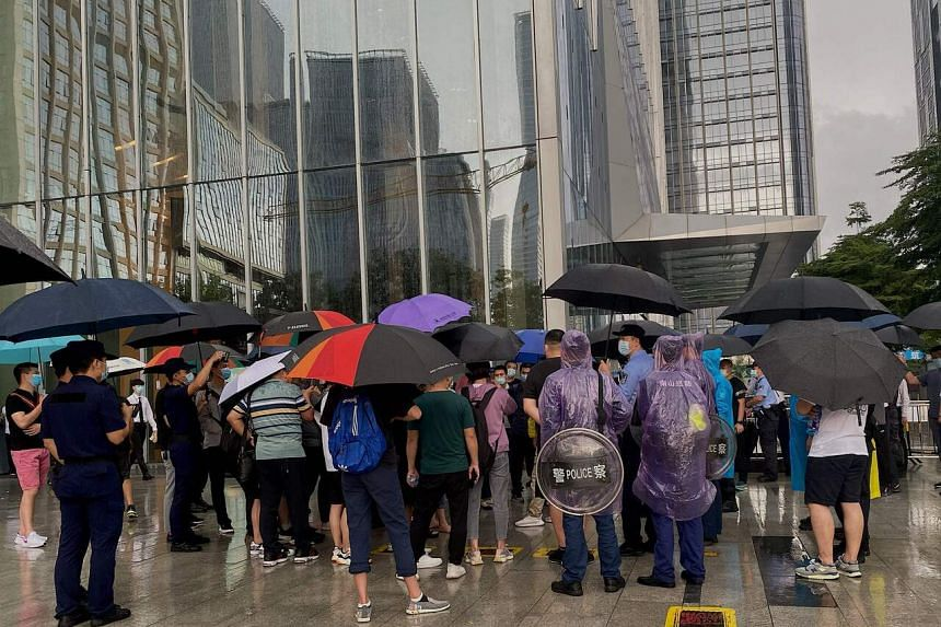 Dozens of anxious investors protested outside the headquarters of troubled Chinese property giant Evergrande on Sept 14, 2021.