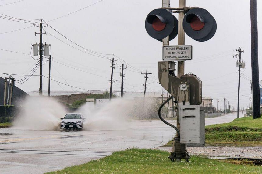 A flooded street in Galveston, Texas, ahead of tropical storm Nicholas on Sept 13, 2021.
