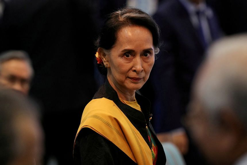"""Ms Suu Kyi's lawyer said she suffered from """"car sickness"""" while being taken to the courtroom."""