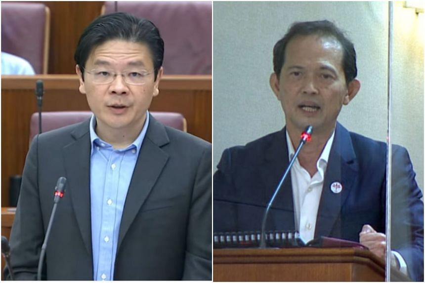 Finance Minister Lawrence Wong and PSP Non-Constituency MP Leong Mun Wai in Parliament on Sept 14, 2021.