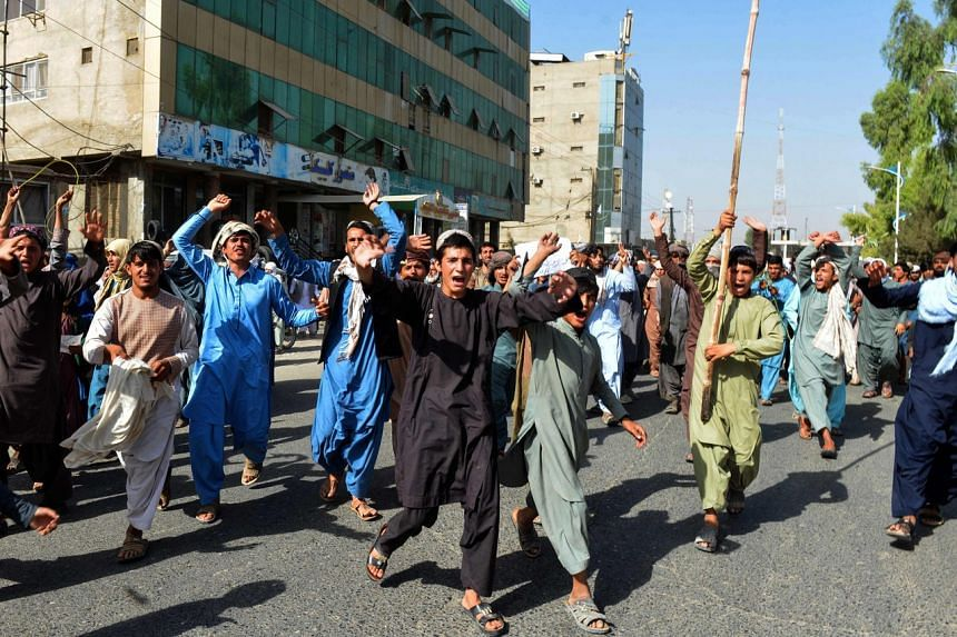 Local residents take part in a protest march against a reported announcement by the Taliban, asking them to evict their homes built on state-owned land in Kandahar on Sept 14, 2021.
