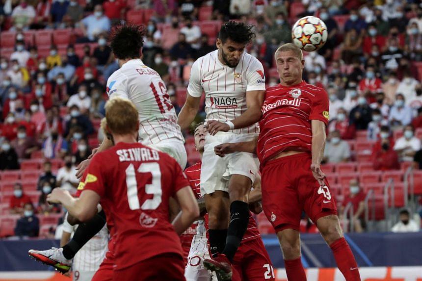 Sevilla's Rafa Mir (second right) in action against Salzburg's Rasmus Nissen Kristensen (right) during the match.