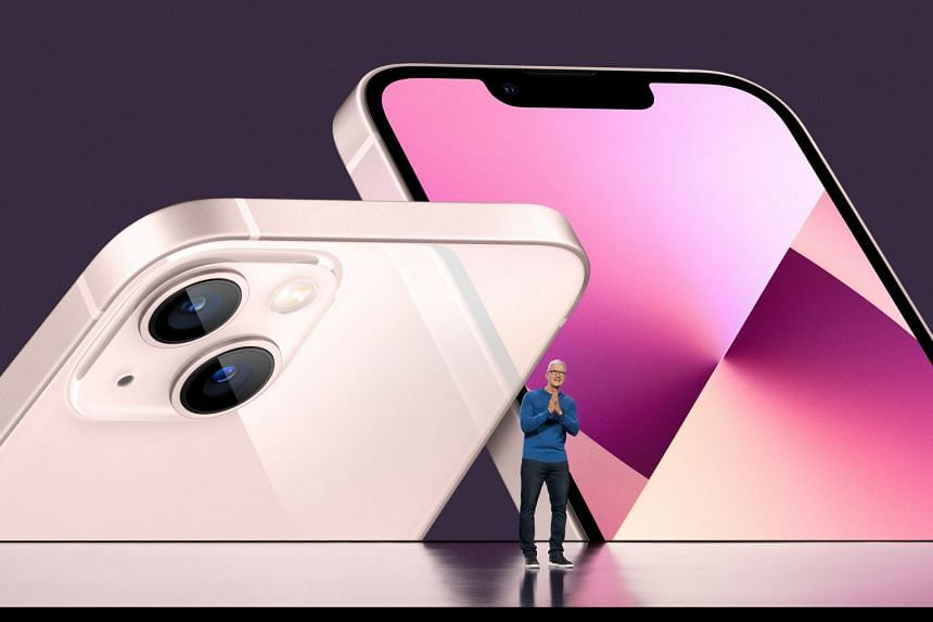 Apple chief executive officer Tim Cook unveils the new iPhone 13 during the Apple Special Event in Cupertino, California.