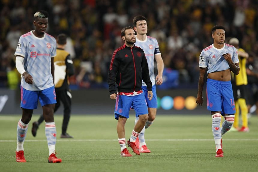 United players (from left) Paul Pogba, Juan Mata, Harry Maguire and Jesse Lingard react after losing the match.