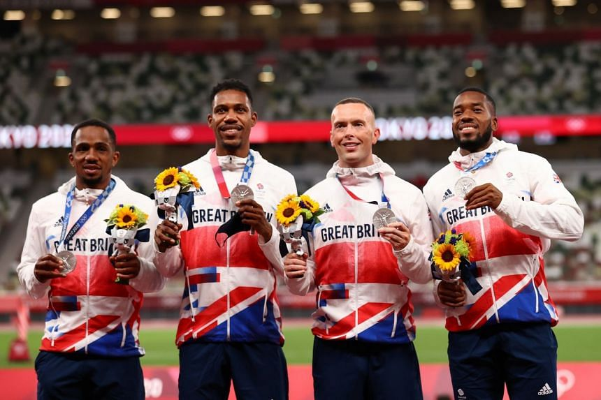 British silver medallists Chijindu Ujah (far left), Zharnel Hughes, Richard Kilty and Nethaneel Mitchell-Blake pose on the podium after their 4 x 100m relay win.