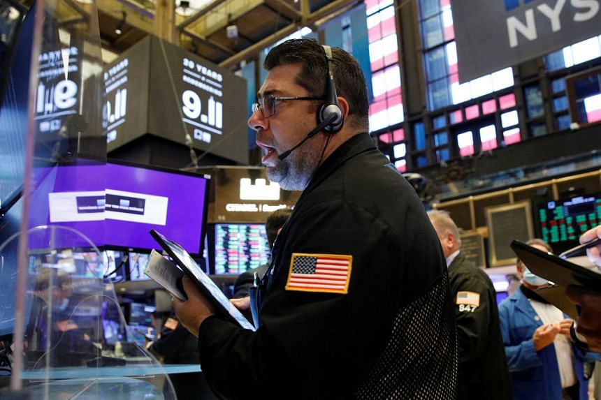 Traders work on the floor at the New York Stock Exchange in New York City.