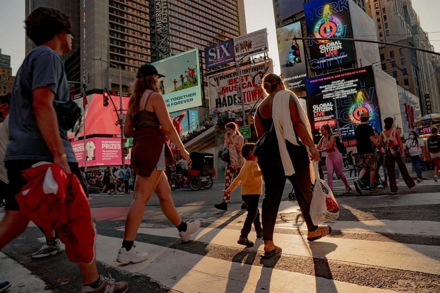 Pedestrians cross a street in the Times Square neighbourhood of New York, on Sept 4, 2021.