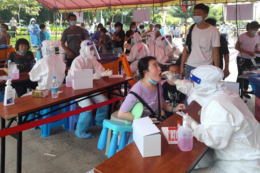 Medical workers conducting Covid-19 tests for residents in Xiamen, Fujian province, China, on Sept 14, 2021.