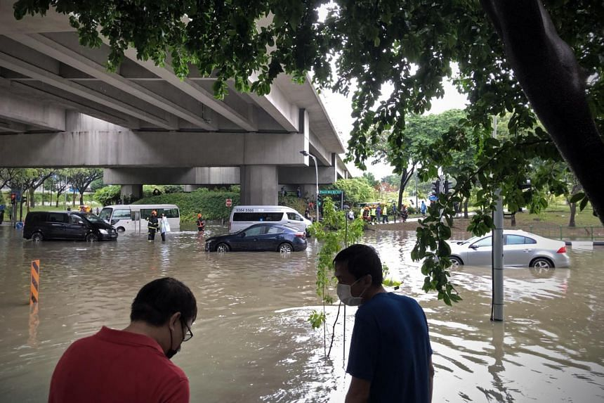 The junction of Tampines Avenue 10 and Pasir Ris Drive 12 was flooded on Aug 20 during a downpour.