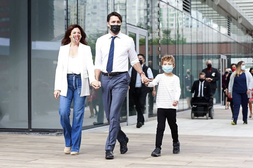 Justin Trudeau walks with his wife Sophie and his son Hadrien during a campaign stop on Sept 13, 2021 in Vancouver.