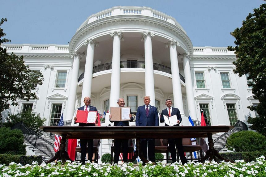 (From left) Bahrain Foreign Minister Abdullatif al-Zayani, Israeli Prime Minister Benjamin Netanyahu, former US President Donald Trump, and UAE Foreign Minister Abdullah bin Zayed Al-Nahyan at the signing of the Abraham Accords at the White House on