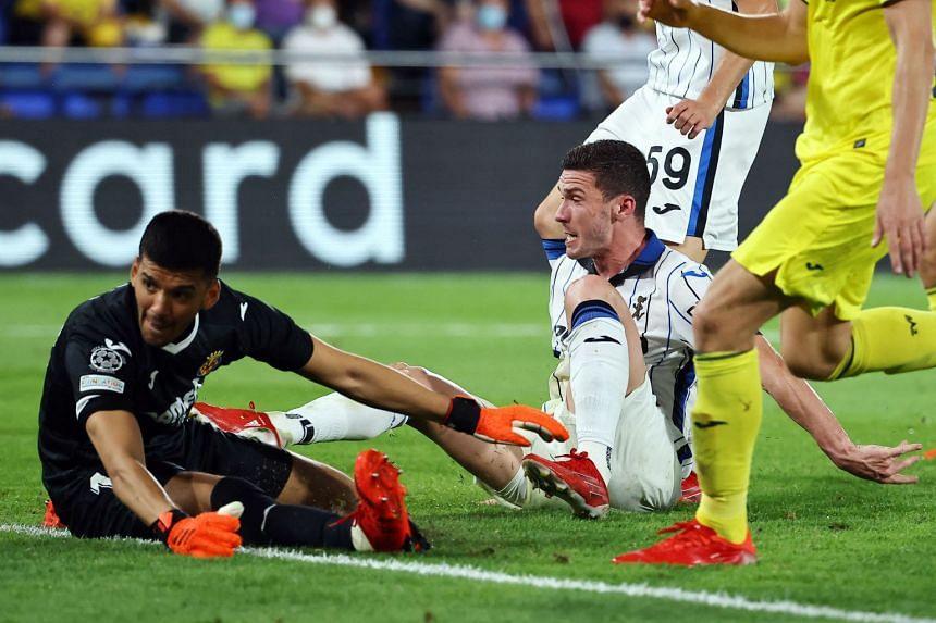 Atalanta's Robin Gosens (right) scores his team's second goal.
