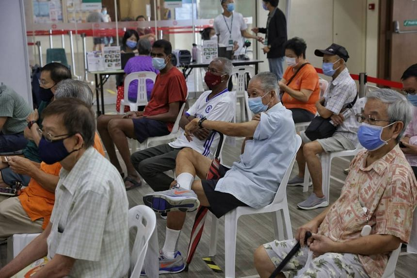 Seniors in the observation zone  waiting to be discharged after receiving their booster jabs at Teck Ghee Community Club on Sept 15, 2021