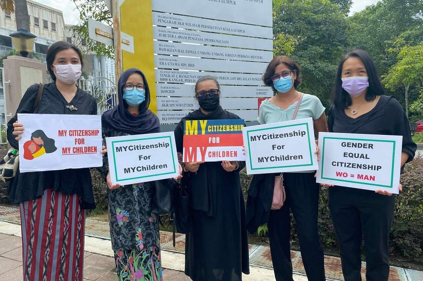 Plaintiffs in the case posing outside the Kuala Lumpur High Court on April 27, 2021.