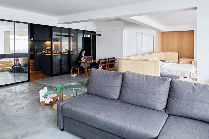 The low-slung furniture, including the dining set and sofa, reflects the couple's preference for being close to the ground.