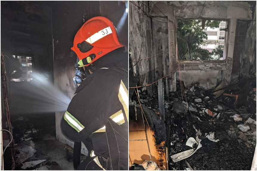An SCDF firefighter using a water jet. The fire involved the contents of a bedroom.