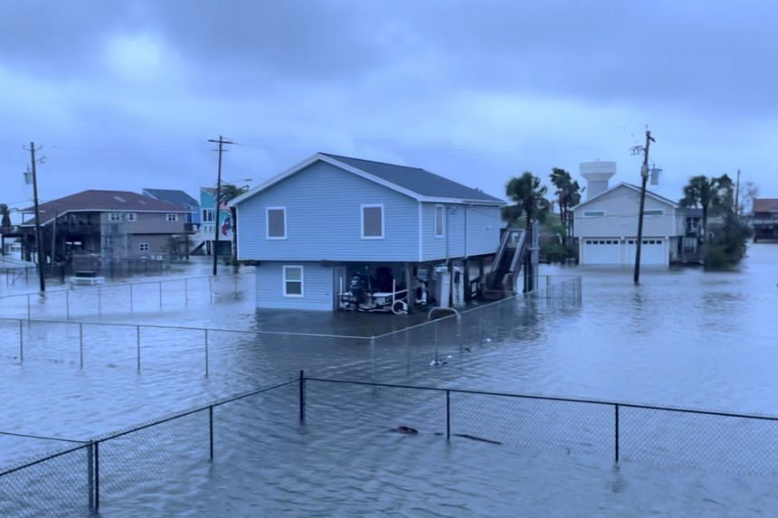 Houses stand in flood waters in the aftermath of Hurricane Nicholas in Jamaica Beach, Texas, on Sept 14, 2021.