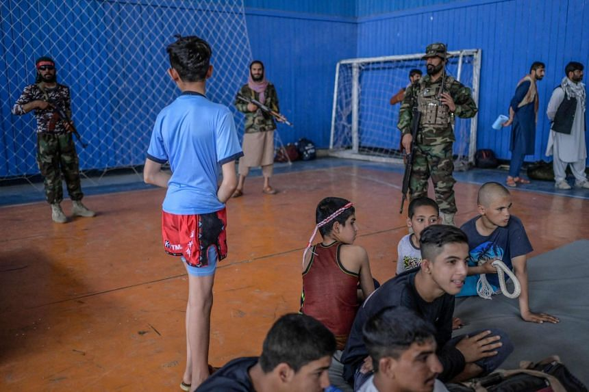 Youths wait to show their skills during an event organised for the visit of Taliban's director of physical education and sports Bashir Ahmad Rustamzai (not pictured) at a gymnasium in Kabul on Sept 14, 2021.