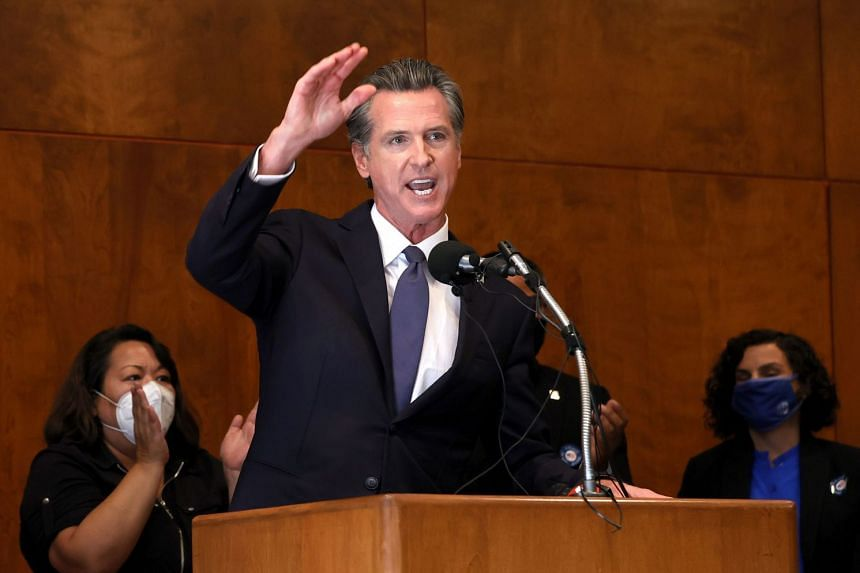 Newsom (above) is fighting for his political future.