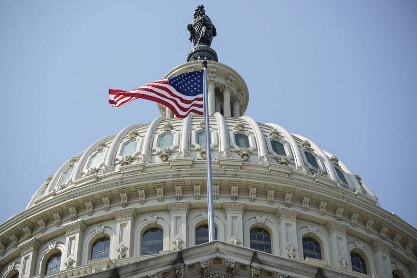 A US flag flies at the US Capitol building in Washington DC on Sept 13, 2021.