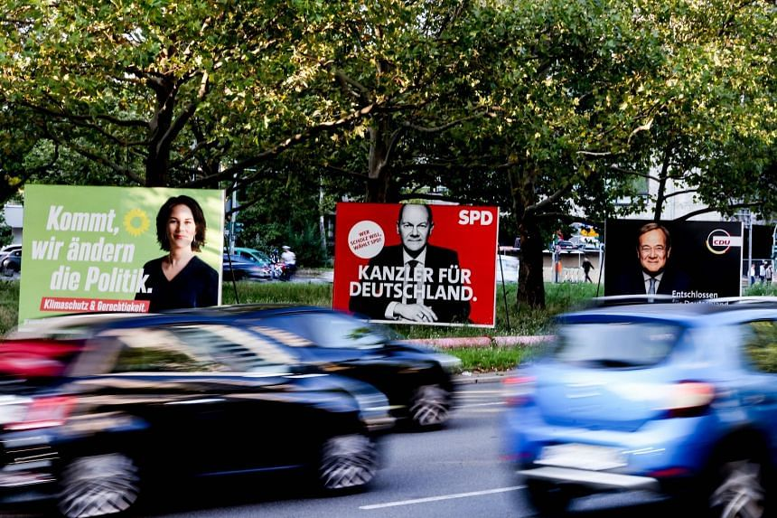Election campaign posters in Berlin show the top candidates for German Chancellor (from left) Annalena Baerbock (Alliance 90/The Greens), Olaf Scholz (Social Democratic Party), and Armin Laschet (Christian Democratic Union).