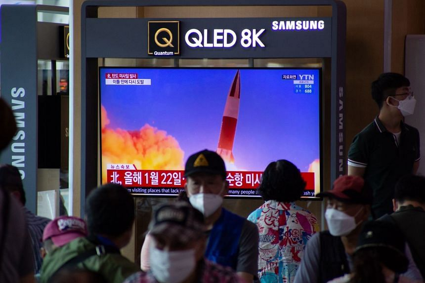 People watch a TV showing breaking news at a station in Seoul, South Korea, on Sept 15, 2021..