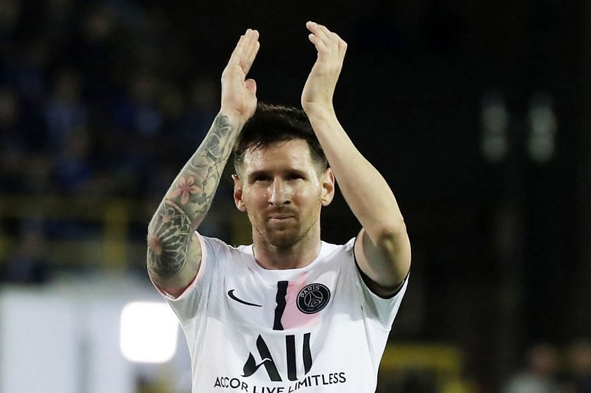 PSG's Lionel Messi applauds fans after the Champions League Group A match against Club Brugge in Belgium.