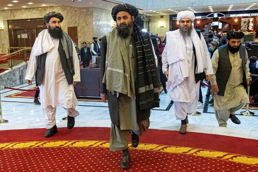Mullah Abdul Ghani Baradar (centre) attends an Afghanistan peace conference in Russia in March 2021.