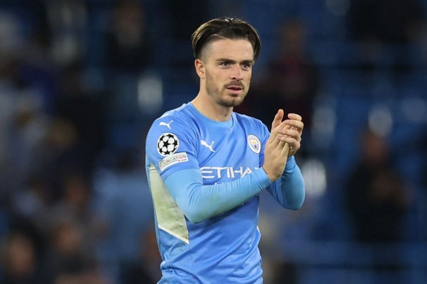 Manchester City's Jack Grealish applauds fans after the match.