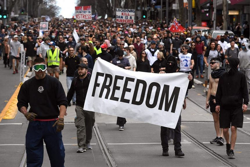 Protesters marching through the streets during an anti-lockdown rally in Melbourne on Aug 21, 2021.