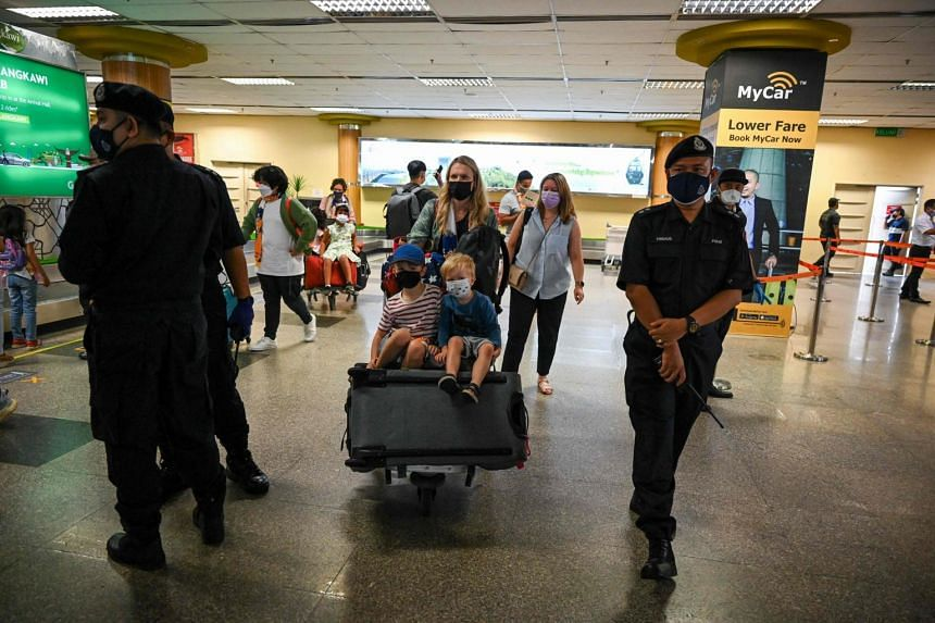 Passengers after their flight landed in Langkawi from Kuala Lumpur International Airport on Sept 16, 2021.