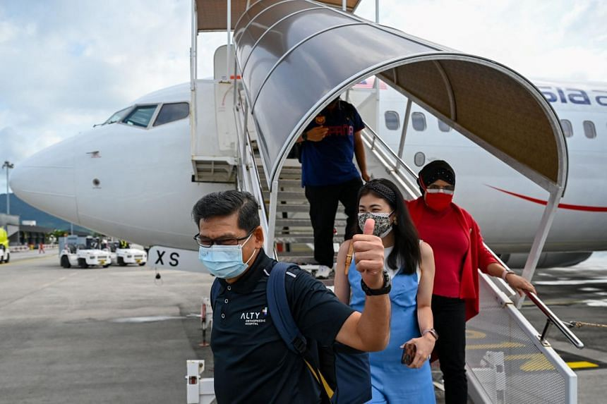 The Boeing 737-800 carrier transporting 159 passengers was the first flight to arrive at Langkawi airport under the travel bubble project.