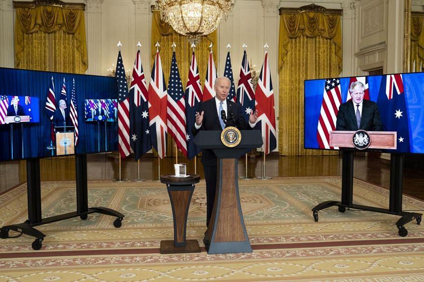 US President Joe Biden announcing the programme at the White House on Sept 15, 2021, with Australian Prime Minister Scott Morrison (left) and British Prime Minister Boris Johnson participating virtually.