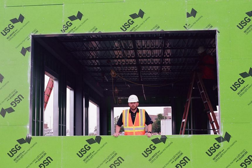 Weber Electric owner Josh Mosier at a construction site in Bloomington, Illinois, on June 18, 2021.