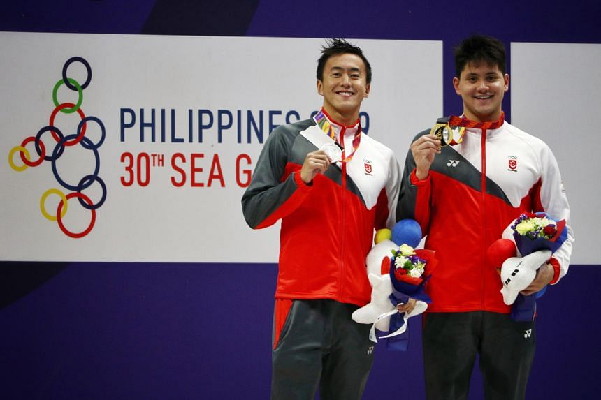The enlistment process for Quah Zheng Wen (left) and Joseph Schooling re-commenced from Aug 31, when their deferments ended.