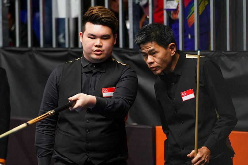 Aloysius Yapp (left) and teammate Toh Lian Han at the SEA Games on Aug 24, 2017.