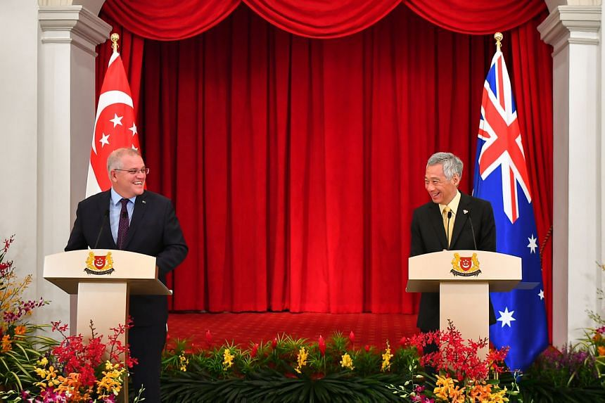 Prime Minister Lee Hsien Loong and Australian Prime Minister Scott Morrison at a joint news conference at the Istana on June 10, 2021.