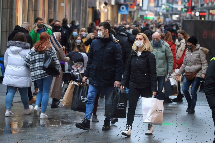 Shoppers wear masks in Cologne's main shopping street in Germany.