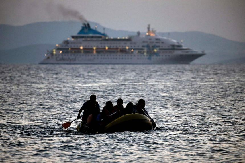 Cameroonian migrants arrive on the shore of Kos island on a small dinghy in this file photo taken on Aug 19, 2015.