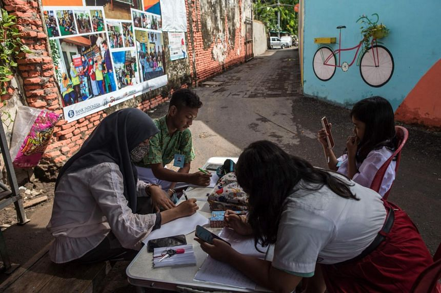 Experts say a pandemic-induced economic shock and the closing of schools for more than a year have been a devastating blow for many of Indonesia's 68 million students.